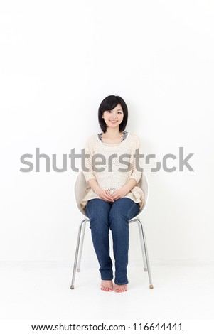 attractive asian woman sitting and relaxing in the room