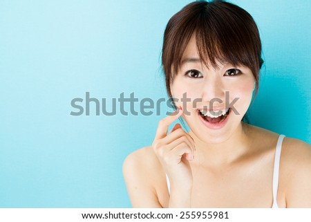 attractive asian woman skin care image on blue background - stock photo