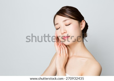 attractive asian woman skin care image on gray background