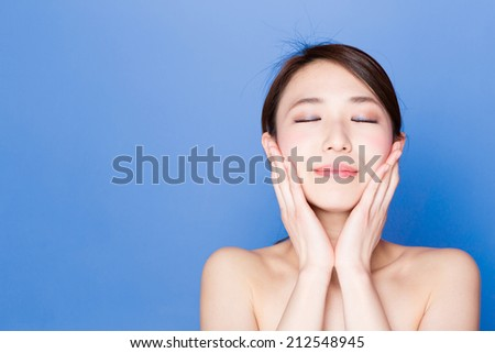 attractive asian woman skincare image on blue background - stock photo