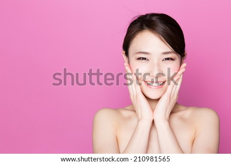attractive asian woman skincare image on pink background - stock photo