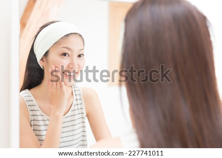 attractive asian woman to see a mirror - stock photo