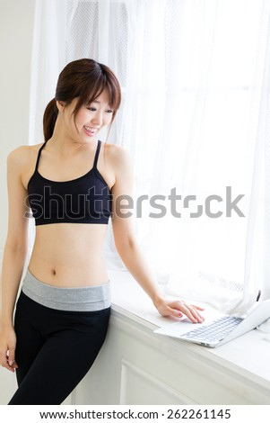 attractive asian woman using laptop - stock photo