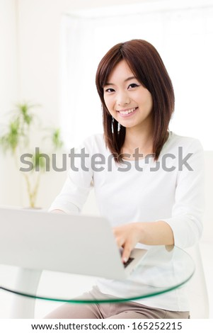attractive asian woman using laptop in the cafe