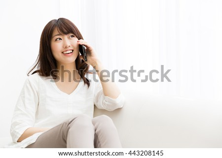 attractive asian woman using smart phone - stock photo
