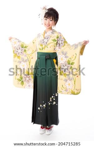 attractive asian woman wearing kimono on white background - stock photo