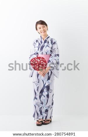 "attractive asian woman wearing traditional Japanese casual summer kimono called ""Yukata"". - stock photo"