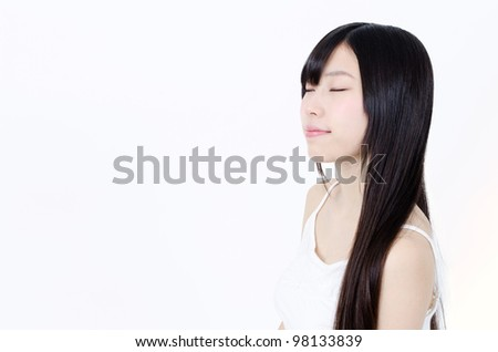 attractive asian woman with black straight hair - stock photo