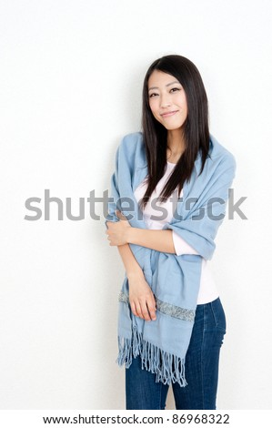 attractive asian woman with shawl - stock photo