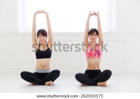 attractive asian women exercising - stock photo