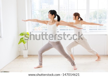 attractive asian women exercising in the room - stock photo