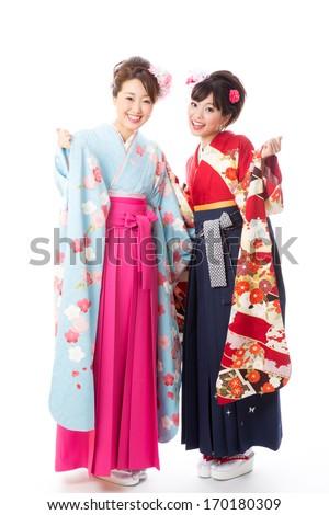 attractive asian women wearing traditional japanese kimono on white background - stock photo