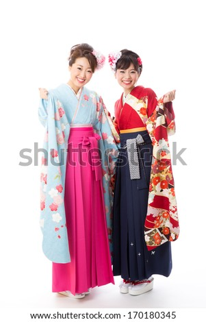 attractive asian women wearing traditional japanese kimono on white background