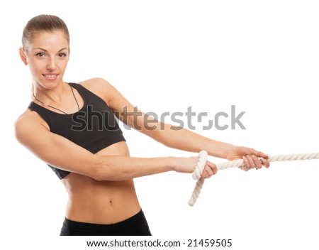 Attractive athletic brunette pulling rope, isolated - stock photo