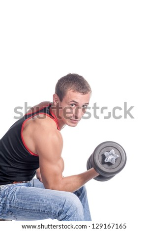 attractive athletic male torso with dumbbell sitting - stock photo
