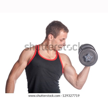 attractive athletic male torso with dumbbell sitting