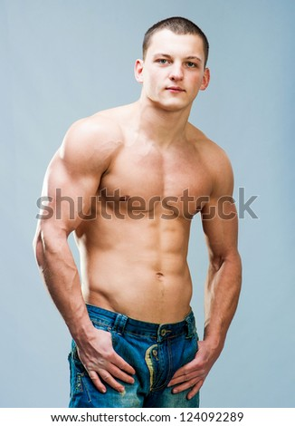 attractive athletic man looking into the camera - stock photo