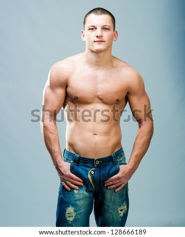 attractive athletic man on a gray background - stock photo