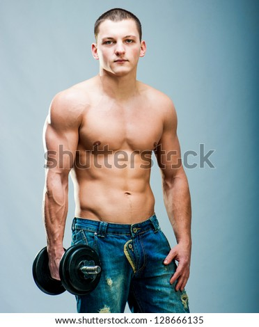 attractive athletic man with dumbbells - stock photo