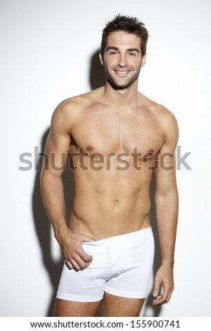 Attractive bare-chested male in underwear - stock photo