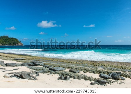 Attractive Beach at Police Bay at Mahe Island, Seychelles with Turquoise Sea Water and White Beach Sand. Captured on Sunny Summer Day. - stock photo