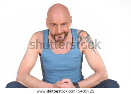 Attractive bearded middle aged man, tattoo on shoulder in sports outfit, fitness concept - stock photo