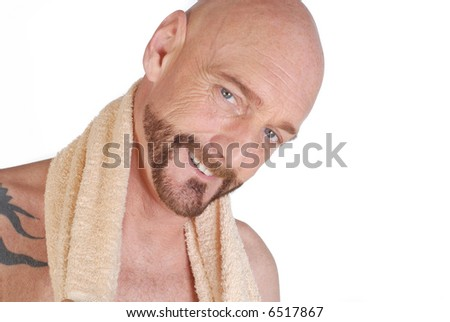 Attractive bearded middle aged man with towel around neck, fitness