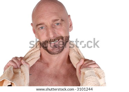 Attractive bearded middle aged man with towel around neck, fitness concept - stock photo
