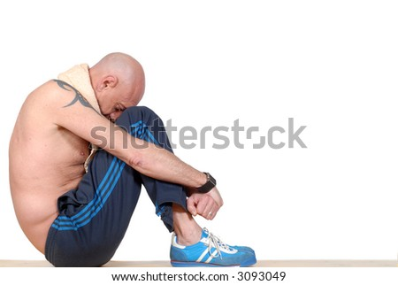 Attractive bearded middle aged man with towel around neck, taking a break, fitness concept - stock photo