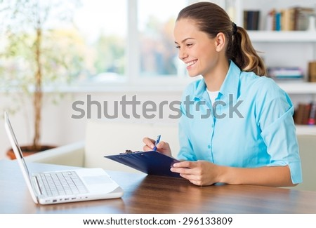 Attractive, beautiful, browsing. - stock photo