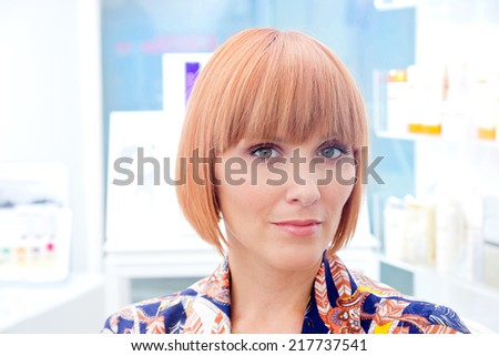 Attractive beautiful red hair woman portrait in beauty salon