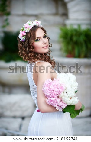 Attractive beautiful woman in greek style - stock photo