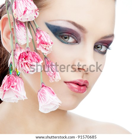 Attractive beautiful woman looking to the camera with pink rose on white background