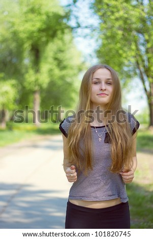attractive beautiful woman running in the park - stock photo