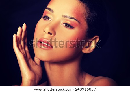 Attractive beautiful woman's face with make up.  - stock photo