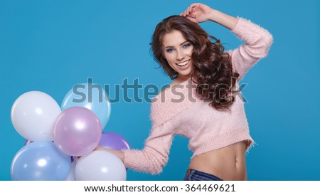 Attractive beautiful  woman with balloons in studio - stock photo