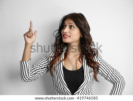 Attractive beautiful young Indian business woman finger point up gesture isolated on white background - stock photo