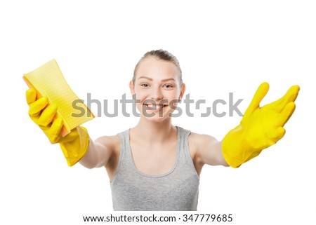 attractive beautiful young woman in yellow rubber gloves holding rag and spray isolated over white