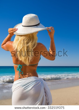Attractive beauty young woman with sarong on the beach