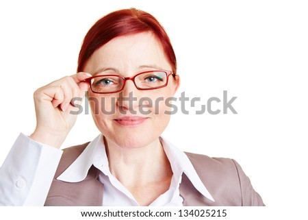 Attractive best ager business woman with red glasses - stock photo