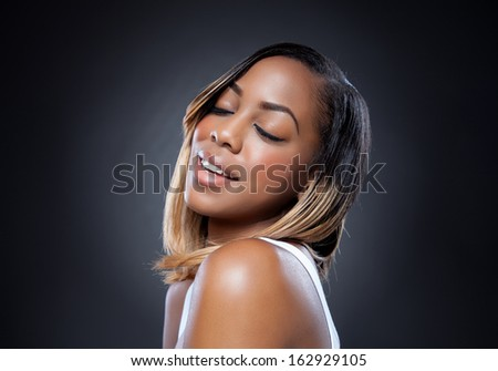 Attractive black beauty with perfect skin smiling - stock photo