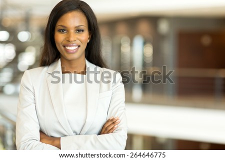 attractive black business executive with arms crossed - stock photo