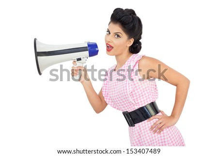 Attractive black hair model using a megaphone on white background