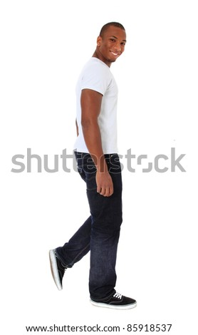 Attractive black man walking. All on white background. - stock photo