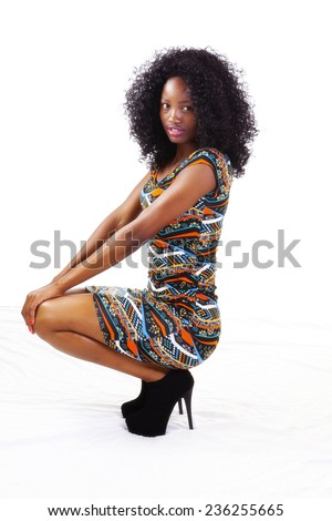 Attractive Black Teen Girl In Dress Squatting