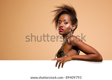 Attractive black woman model standing behind large white banner - stock photo