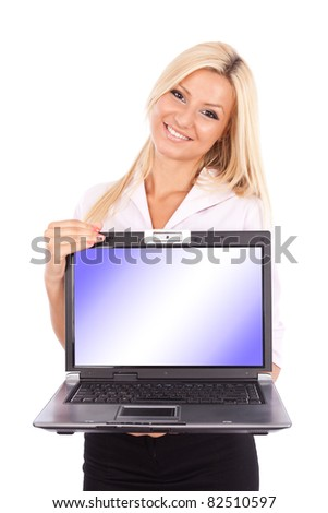 Attractive blond and young businesswoman showing a laptop screen with copyspace