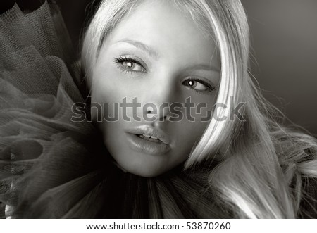 Attractive blond beauty in a theatrical jabot. Photo. - stock photo
