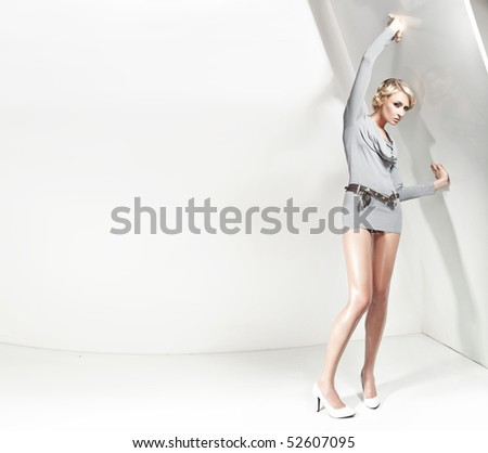 Attractive blond beauty, plenty of copy-space - stock photo