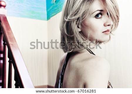 Attractive blond beauty with light background - stock photo
